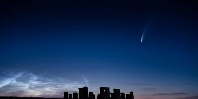 The comet was seen streaking over Stonehenge on a perfect summer's evening. (Credit: SWNS)