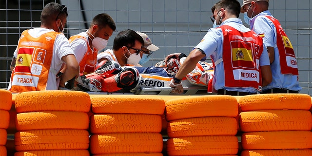 Marquez walked away from the crash, but was taken to the medical center on a stretcher.