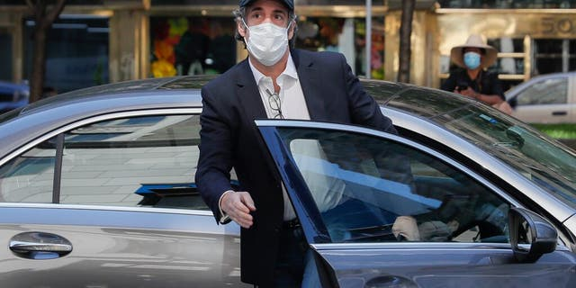 Michael Cohen arrives at his Manhattan apartment, May 21, 2020, in New York. (AP Photo/John Minchillo)