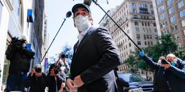Michael Cohen arrives at his Manhattan apartment, Thursday, May 21, 2020, in New York. President Donald Trump's longtime personal lawyer and fixer was released federal prison Thursday and is expected to serve the remainder of his sentence at home.