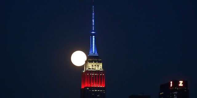 The full buck moon rises behind the Empire State Building on July 4, 2020 as seen from Weehawken, New Jersey. (Photo by Gary Hershorn/FOX News)