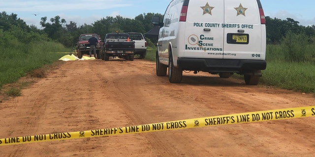 Crime scene tape shows spot where three close friends were killed in Polk County in Florida on Friday night.