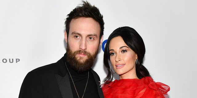 Kacey Musgraves (R) and Ruston Kelly attend the Universal Music Group's 2019 After Party To Celebrate The GRAMMYs at ROW DTLA on February 10, 2019 in Los Angeles, Calif.