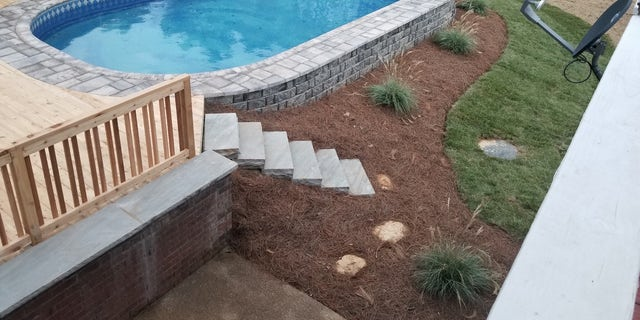 But perhaps the easiest, and most affordable, way to hide the hardware of an above ground pool is through strategically-located landscaping, rocks and lighting.