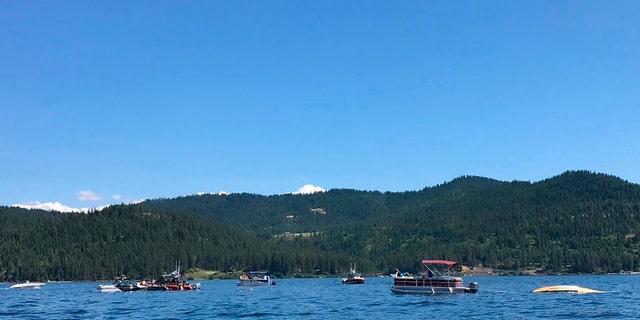 Boaters reacting to the crash near Powderhorn Bay on Lake Coeur d'Alene on Sunday, south of Coeur d'Alene, Idaho.