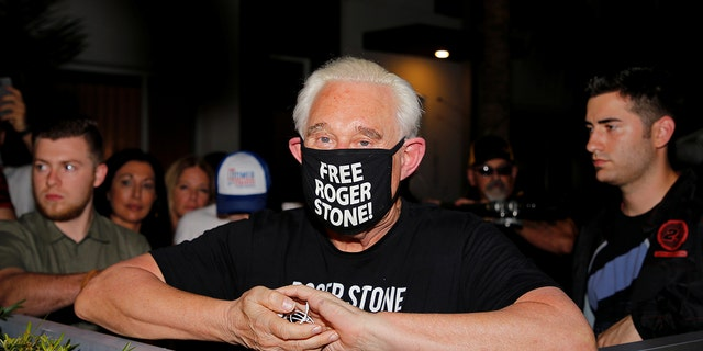 Roger Stone, a longtime friend and adviser of U.S. President Donald Trump, reacts after Trump commuted his federal prison sentence outside his home in Fort Lauderdale, Florida, U.S. July 10, 2020. REUTERS/