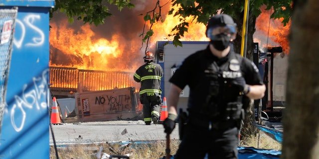 Construction buildings burn near the King County Juvenile Detention Center on Saturday, shortly after a group of protesters left the area. (AP)