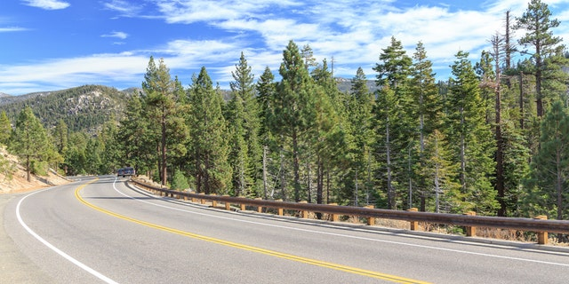 Highway curves through the mountains at Tahoe National Forest, California, USA.