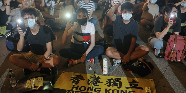 Supporters of Hong Kong anti-government movement gather at Liberty Square, to mark the one-year anniversary of the start of the protests in Hong Kong, in Taipei, Taiwan, June 13, 2020. REUTERS/Ann Wang - RC2F8H9ZDYKZ