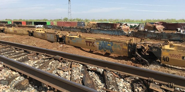Dozens of train cars derailed after a severe thunderstorm blasted a West Texas community on Tuesday night.