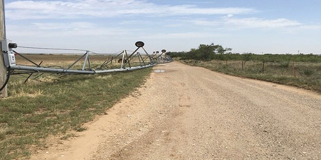 An irrigation system was also toppled by straight-line winds on Tuesday.