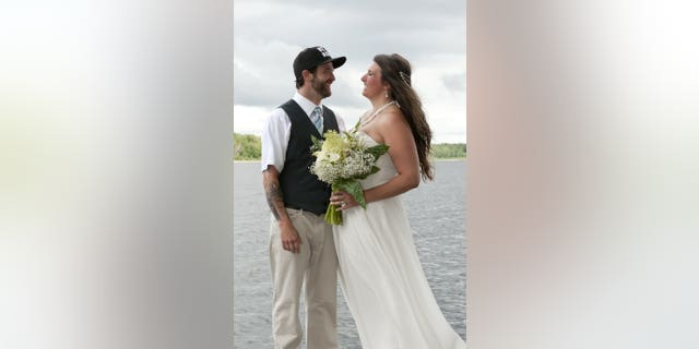 Canadian couple Lora Wendorf and Jordan Devries were posing for photos on a riverside dock on the big day when they broke out a bold dance move for a dramatic picture.