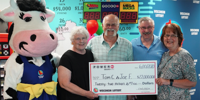 Tim Cook, Joe Feeney and their wives, collecting the prize-winning check