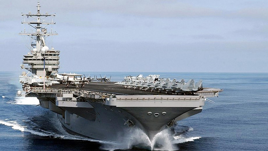 US Navy carriers steam near Iranian coast in show of power