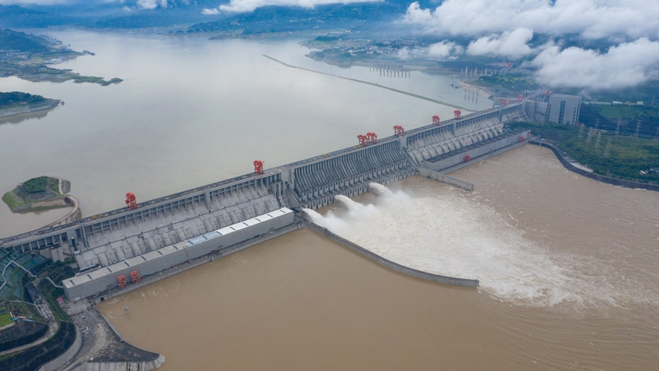 House crashes into river after heavy flooding in China