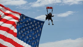 Double-amputee veteran skydives above Sturgis rally with giant US flag, Trump 2020 parachute