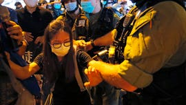 Hong Kong police issue arrest warrant for US citizen amid crackdown on pro-democracy activists
