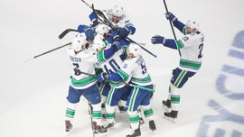 Canucks beat Wild 5-4 after Tanev scores 11 seconds into OT