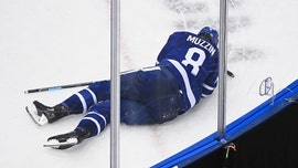 Maple Leafs' Jake Muzzin carried off ice after collision with Blue Jackets player