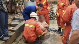 Chinese man's big belly saves him from falling down well