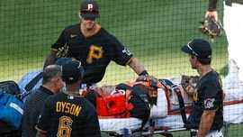 Pirates' Phillip Evans involved in scary collision with teammate, stretchered off the field