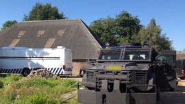 Dutch police uncover Netherland's largest-ever cocaine lab in former riding school, arrest 17 suspects