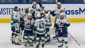 Motte scores twice, Canucks rally to beat Blues 4-3
