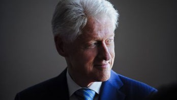 Bill Clinton seen getting neck massage from Jeffrey Epstein accuser in newly uncovered 2002 photos
