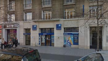 Armed man with ties to radical Islam takes hostages at French bank for six hours, police say