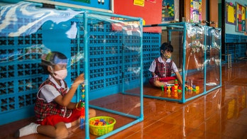Coronavirus in Thailand: Students seen playing inside pens to protect against spread