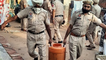 Tainted alcohol in India kills dozens, spurring authorities to conduct over 100 raids