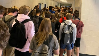 Georgia school reopenings: Elementary student tests positive for coronavirus, student crowds raise questions