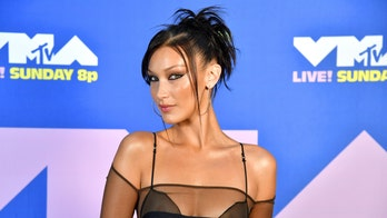 Bella Hadid shares steamy bikini snaps from her new Versace campaign