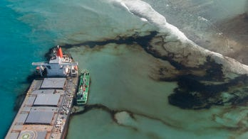 Mauritius drains oil from stricken ship, but environmentalists fear extent of damage