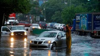 Isaias slams Philadelphia, triggers major flooding along Schuylkill River as barge wedged under bridge