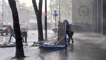 Tropical Storm Isaias' fierce winds toss NYC flood barriers on city streets, injure person