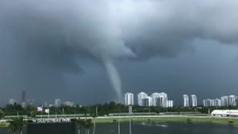 Waterspout slides up South Florida beach: See the video