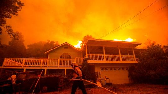 California firefighters fear heat wave, winds will intensify massive LA blaze