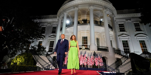 President Donald Trump and first lady Melania Trump arrive for his acceptance speech to the Republican National Committee Convention on the South Lawn of the White House, Thursday, Aug. 27, 2020, in Washington. (AP Photo/Evan Vucci)