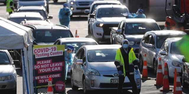 Cars queue at a COVID-19 test centre in Auckland, New Zealand, Aug. 13. Health authorities in New Zealand are scrambling to trace the source of a new outbreak of the coronavirus as the nation's largest city goes back into lockdown. (AP Photo/Dean Purcel)