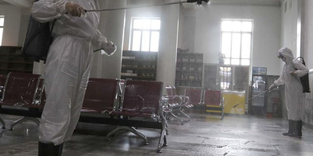 Women in protective suits disinfect a hall at Pyongyang Railway Station to help curb the spread of the coronavirus in Pyongyang, North Korea, on Thursday, August 13, 2020. (AP Photo / Jon Chol Jin)