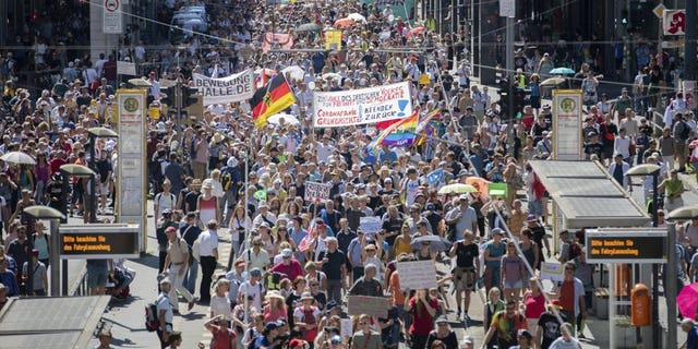 "Thousands march along the 'Friedrichstrasse' during the demonstration against corona measures in Berlin, Germany, Saturday, Aug. 1, 2020. The initiative ""Querdenken 711"" has called for this. The motto of the demonstration is ""The end of the pandemic - Freedom Day""."