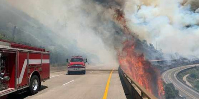 Crews respond to the Grizzly Creek Wildfire burning near Interstate 70 in Colorado on Monday, Aug. 10, 2020.