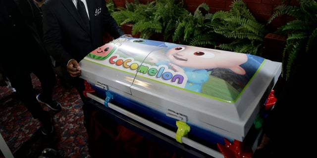 A small casket containing the body of Davell Gardner, Jr. is wheeled out of the church after his funeral service in the Brooklyn borough of New York, on July 27. Authorities are investigating the July 12 shooting that left the 1-year-old boy dead and injured three adults. (AP)