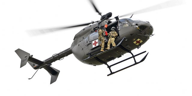 Louisiana National Guardsmen from Delta Company, 2-151st Aviation Regiment conduct recertification training on a LUH-72 Lakota helicopter hoist system used for rescue operations at the Hammond Regional Airport ahead of Hurricane Laura, Aug. 25, 2020. Guardsmen continue to prepare to respond to the citizens of Louisiana prior to landfall of Hurricane Laura. (U.S. Air National Guard photo by Master Sgt. Toby Valadie)