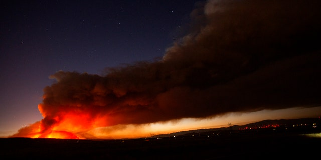 The Lake Hughes fire sends a plume of smoke over Angeles National Forest on Wednesday, Aug. 12, 2020, north of Santa Clarita, Calif.