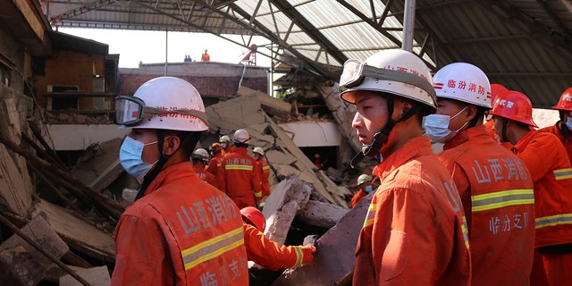 Rescuers search for victims in the aftermath of the collapse of a two-story restaurant in Xiangfen county in northern China's Shanxi province on Saturday, Aug. 29, 2020. (Chinatopix Via AP)