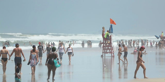 Daytona Beach, Fla., crowded with beachgoers Saturday, Aug. 1, 2020. (Stephen M. Dowell/Orlando Sentinel via AP)