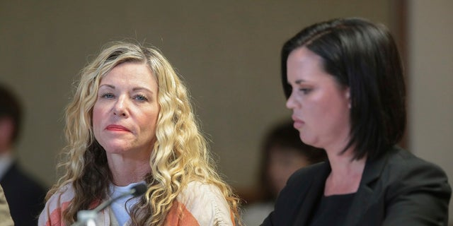 Lori Vallow Daybell glances at the camera during her hearing, with her defense attorney, Edwina Elcox, right, in Rexburg, Idaho. Arizona authorities said she will most likely be charged in connection with the death of her former husband.