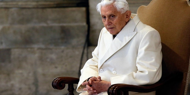 Dec. 8, 2015: Pope Emeritus Benedict XVI attends a Mass prior to the opening of the Holy Door of St. Peter's Basilica, formally starting the Jubilee of Mercy, at the Vatican. Emeritus Pope Benedict XVI has fallen ill after his return from a trip to his native Bavaria to visit his brother, who died a month ago, a German newspaper reported Monday. (AP Photo/Gregorio Borgia)